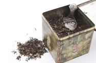 Tealeaves in antique tea box Stock Photos