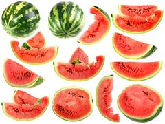 set of fresh slices and full a ripe watermelons - stock photo