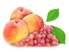 red grape and peachs with green leaf - stock photo