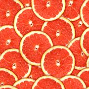 Seamless pattern of red grapefruit slices Stock Photos