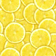 Seamless pattern of yellow lemon slices Stock Photos