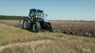 Stock Video Footage of Tractor plowing, side view