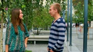 Young couple having fun talking. Stock Footage
