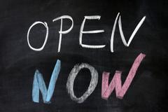 """""""open now"""" words written on chalkboard - stock photo"""