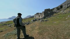 Greenland Hvalso Nordic church ruin with man Stock Footage