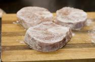 Three veal shanks in flour Stock Photos