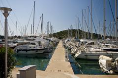 Sailing boats berthed in the marina in Betina, on Murter Stock Photos