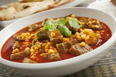 lamb curry with naan bread - stock photo