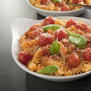 Fusilli pasta with cherry tomatoes, parmesan and ricotta square Stock Photos