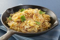 potatoes fried with onions pommes de terre lyonnaise - stock photo