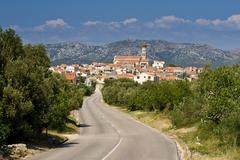 Panoramic view to Betina with the town in the distance - stock photo