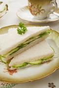 cucumber sandwiches on old fashioned crockery - stock photo