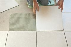 Laying ceramic tiles Stock Photos