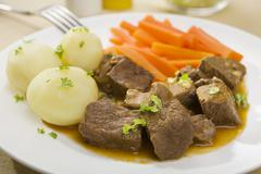 Beef stew with potatoes and carrots Stock Photos