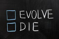 evolve or die - stock photo