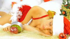 Santa claus female sleeping late for christmas Stock Footage