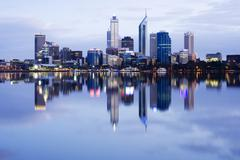 perth skyline reflected in the swan river - stock photo
