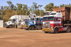 road trains taking on gas or diesel - stock photo