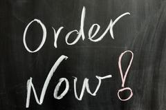 """Stock Photo of chalk drawing - """"order  now"""" word on the chalkboard"""