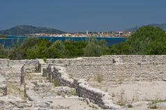 Archeological site and view to Pirovac - stock photo