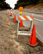 Construction Cones and Barricades Along Street - stock photo
