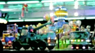 Children on the carousel at luna park. Blurred, out of focus. Stock Footage