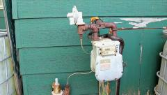 A Black Ratsnake slithers along a gas meter in Ontario, Canada. Stock Footage