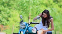 Woman with a motorcycle Stock Footage