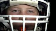 Boy in Football gear looking at camera Stock Footage
