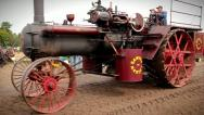 Men operating an old-fashioned steam engine tractor in Waterloo, Ontario. Stock Footage