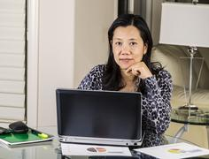Women relaxing while working at home office Stock Photos