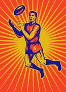aussie rules player jumping catching ball - stock illustration