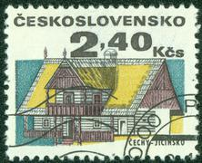 stamp printed in Czechoslovakia shows wooden houses , circa 1971 - stock photo