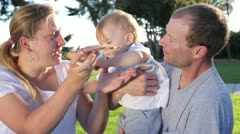 Mother Tries to Feed Pizza Slice to Toddler Who Pushes Her Hand Away Stock Footage