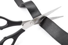 Scissors cutting black ribbon Stock Photos