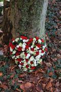 Hearth shaped sympathy floral arrangement Stock Photos