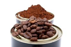 coffee beans in tin cans - stock photo