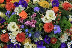 mixed floral arrangement in bright colors - stock photo