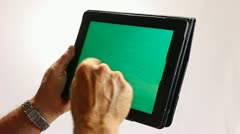 GREENSCREEN HANDS WORKING ON A TABLET COMPUTER 2 Stock Footage