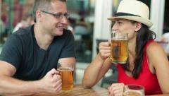 Group of friends drinking beer in the restaurant, outdoors Stock Footage