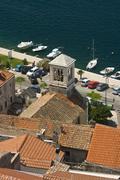 Panorama of Sibenik roofs, church tower and coast Stock Photos