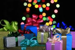 Gifts on a background of colored balls Stock Photos