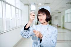 smiling nurse in the infusion - stock photo