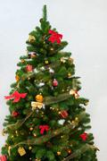 Christmas tree with red and golden decorations Stock Photos