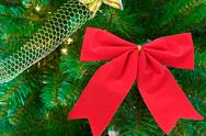 Stock Photo of red bow on christmas tree