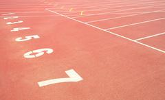 Sport track running with numbers on stadium Stock Photos
