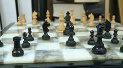 Chess board and books dolly shot Stock Footage