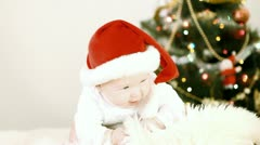 Baby in Christmas hat on the new year background Stock Footage