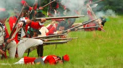 Redcoats on Ground and Firing on Battlefield Stock Footage