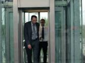 Business people coming out from the elevator Stock Footage